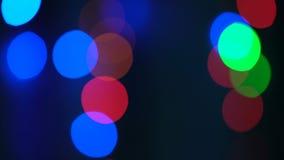 Luces coloridas del bokeh y de la Navidad almacen de metraje de vídeo