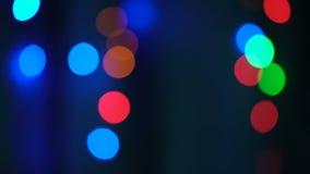 Luces coloridas del bokeh y de la Navidad metrajes