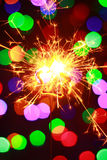 Luces 2016 de Bengala del Año Nuevo bajo la forma de estrellas Foto de archivo libre de regalías