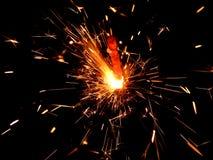 Luces de Bengala del Año Nuevo con las chispas en un fondo negro Imagen de archivo