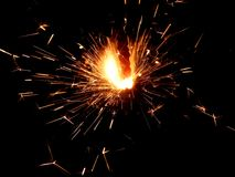 Luces de Bengala del Año Nuevo con las chispas en un fondo negro Fotografía de archivo