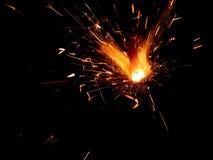 Luces de Bengala del Año Nuevo con las chispas en un fondo negro Foto de archivo