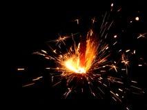 Luces de Bengala del Año Nuevo con las chispas en un fondo negro Foto de archivo libre de regalías
