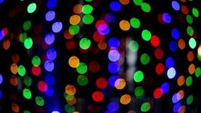 Luces de Bokeh Fondo hermoso de la Navidad La Navidad y Año Nuevo Extracto festivo del fondo de la luz de la Navidad almacen de metraje de vídeo