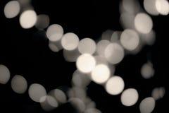 luces De-enfocadas en la oscuridad Puntos borrosos del tiro del bokeh de la decoración Negro del vintage y color crema ricos Fotos de archivo libres de regalías