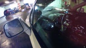 Luces de estacionamiento subterráneos reflejadas en ventanilla del coche 4K almacen de metraje de vídeo