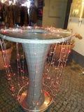 Luces de hadas rojas en una tabla Fotografía de archivo