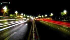 Luces de la carretera de la noche Fotos de archivo libres de regalías