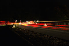 Luces de la cola en la noche Fotos de archivo