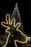 Luces de la luz y del árbol de navidad del reno Foto de archivo libre de regalías