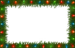 Luces de la Navidad con la frontera del pino Fotografía de archivo