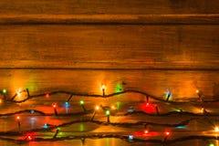 Luces de la Navidad en el fondo de madera Copie el espacio Imagen de archivo libre de regalías