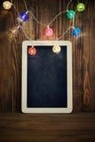 Luces de la Navidad en fondo de madera Foto de archivo libre de regalías