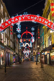 Luces de la Navidad en la calle de Carnaby, Londres Reino Unido Foto de archivo