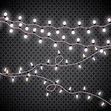 Luces de la Navidad Guirnalda que brilla intensamente en fondo transparente Luces brillantes Fotografía de archivo libre de regalías