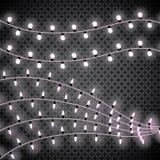 Luces de la Navidad Guirnalda que brilla intensamente en fondo transparente Luces brillantes Imagenes de archivo