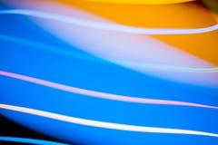 Luces de la Navidad mezcladas brillantes coloridas que fluyen en diversas direcciones Foto de archivo libre de regalías
