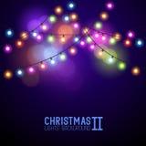 Luces de la Navidad que brillan intensamente coloridas Foto de archivo