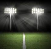 Luces de la noche del juego del estadio en negro Fotografía de archivo libre de regalías