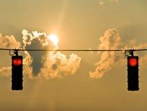 Luces de la parada de la salida del sol Foto de archivo libre de regalías
