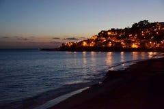 Luces de la playa y del país de la puesta del sol Foto de archivo