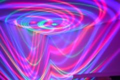 Luces de neón que remolinan de la diversión Imagenes de archivo