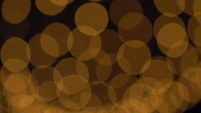Luces de oro de Bokeh que centellan el fondo almacen de video