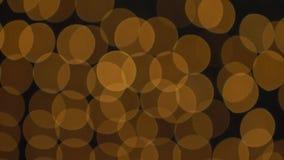 Luces de oro de Bokeh que centellan el fondo almacen de metraje de vídeo
