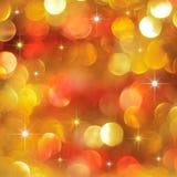 Luces de oro y rojas del día de fiesta Imagen de archivo libre de regalías