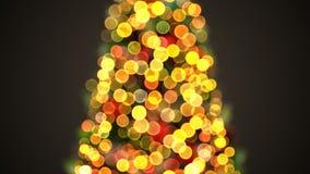 Luces Defocused del árbol de navidad que oscilan en la animación colocada 3d Feliz Navidad y celebración de la Feliz Año Nuevo metrajes