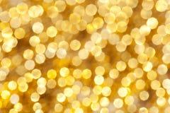 Luces Defocused del oro de la Navidad Fotos de archivo