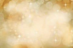 Luces Defocused del oro de la Navidad Fotos de archivo libres de regalías