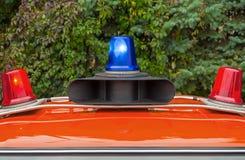 Luces del coche de la milicia de la policía Foto de archivo
