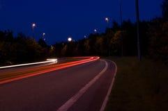 Luces del coche, foto de la noche Fotografía de archivo