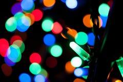 Luces del día de fiesta de una guirnalda Imagenes de archivo