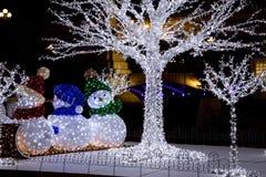 Luces del muñeco de nieve imagenes de archivo