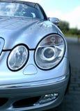 Luces delanteras del coche de Mercedes Imágenes de archivo libres de regalías