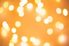 Luces festivas de oro borrosas Foto de archivo