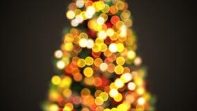Luces hermosas del árbol de navidad que oscilan en la falta de definición Defocused Bokeh Saludo de la animación inconsútil 3d de almacen de video