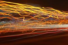 Luces móviles rojas, anaranjadas y amarillas Fotografía de archivo libre de regalías