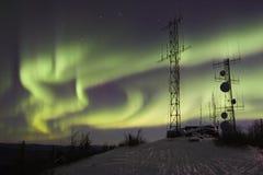 Luces norteñas sobre las antenas Imágenes de archivo libres de regalías
