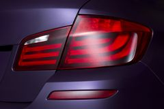 Luces posteriores rojas del coche Imágenes de archivo libres de regalías