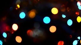 Luces que centellean, guirnalda borrosa abstracta del día de fiesta del bokeh almacen de video