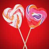 Lucettes sur des bâtons sous forme de coeur Image stock