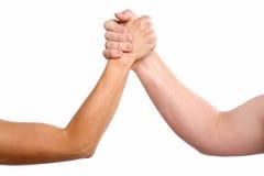 Lucha de brazo del hombre y de la mujer Imágenes de archivo libres de regalías