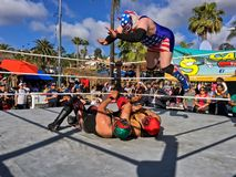 Lucha Libre Mexican Wrestling. Lucha Libre match in Old Town, San Diego, California with a wrestler performing a body drop. Lucha libre is Spanish for free fight