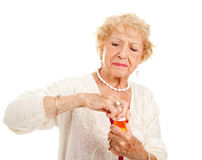 Lucha para abrir píldoras Fotografía de archivo libre de regalías