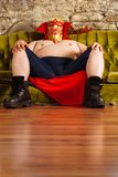 Luchador sitting on a couch Stock Images