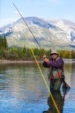 Luchar un pescado Foto de archivo libre de regalías