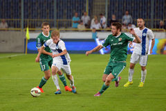 Luchkevych Valeriy beat two opponents and running after the ball Stock Images